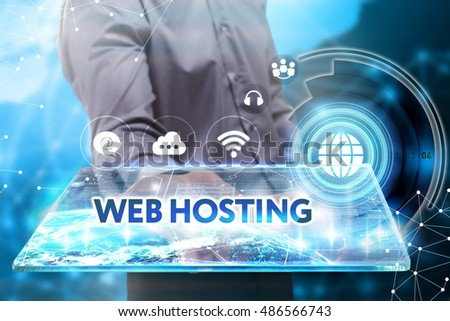 Business, Technology, Internet and network concept. Young businessman working on a tablet of the future, he sees the inscription: web hosting