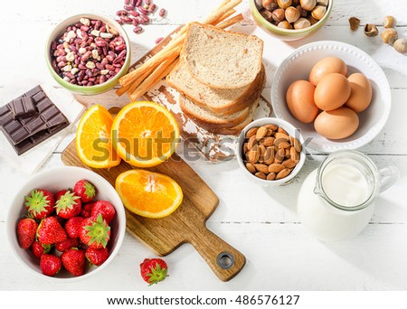 Allergy food concept. Allergic food on white wooden background. Top view #486576127