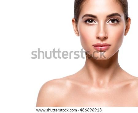 Beautiful woman face close up studio on white #486696913
