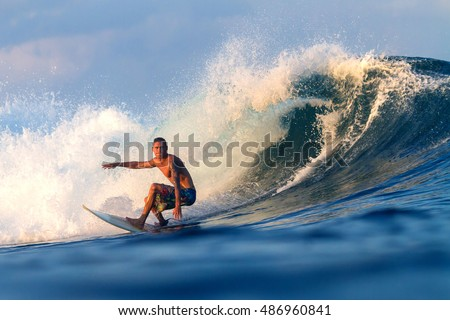 Picture of Surfing a Wave.Sumbawa Island. Indonesia. Royalty-Free Stock Photo #486960841