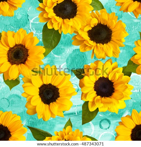 Seamless pattern made up by photos of yellow sunflowers with green leaves, on a teal blue watercolor texture with hand painted circles #487343071