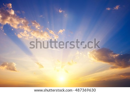 Sunrise with strong color clouds light rays and other atmospheric effects #487369630
