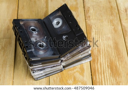 the magnetic cartridge for the tape recorder on a wooden table #487509046