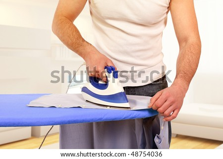 modern man lifestyle, ironing clothes and homework background