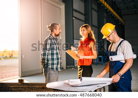 Construction Site Inspector making report on big industrial construction site #487668040