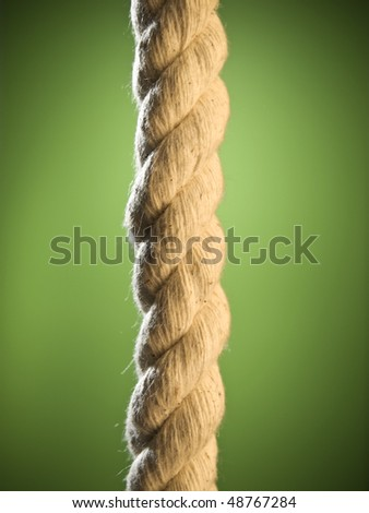 Close up of a brown rope over a green background. #48767284