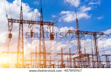 Silhouette of power plant and transformer substation batteries, the beautiful sky with the sun at sunset. #487890967