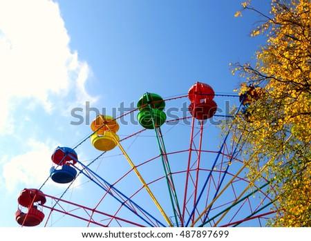 Ferris wheel in the park outdoor attraction entertainment joy september october carousel #487897699
