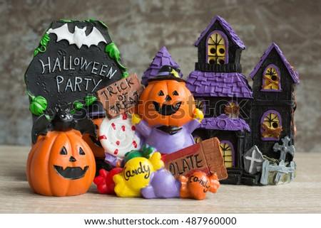 Halloween cartoon set on wooden background.