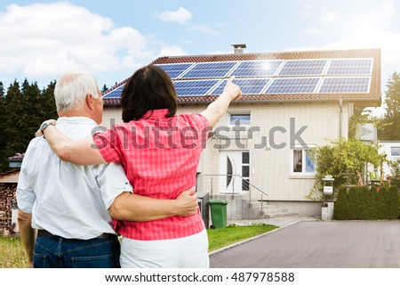 Rear View Of Senior Couple Pointing Finger In Front Of House #487978588