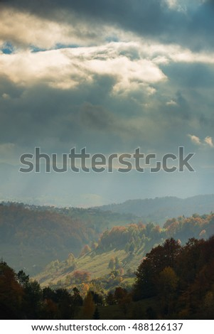 Autumn panorama in the mountains, at sunset #488126137
