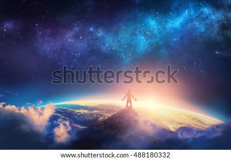 A man climbs a high mountain and lifts his arms up in praise. 3D illustration. Elements provided by NASA Royalty-Free Stock Photo #488180332