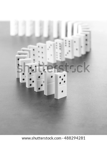 Dominoes standing on gray background #488294281