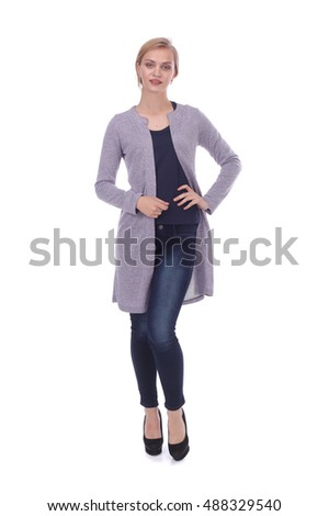 pretty young girl wearing jeans and cardigan #488329540