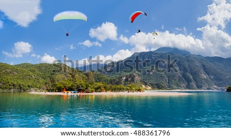 Paragliding over the sea and the mountains, Oludeniz #488361796