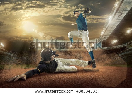 Baseball players in action on the stadium. #488534533