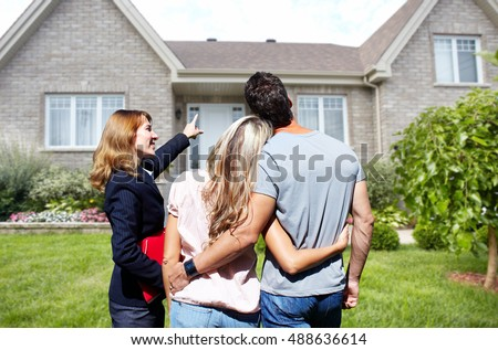 Real Estate agent woman with clients near new house. #488636614