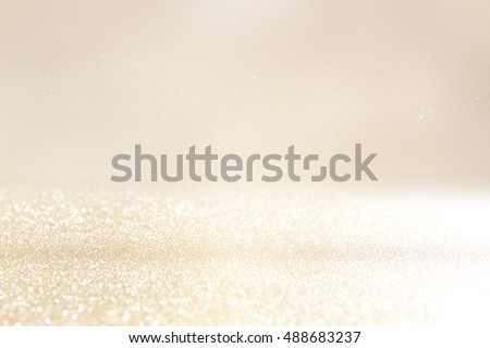 glitter vintage lights background. silver and gold. de-focused