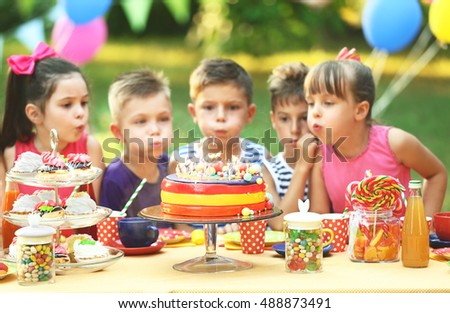 Children celebrating birthday in park #488873491