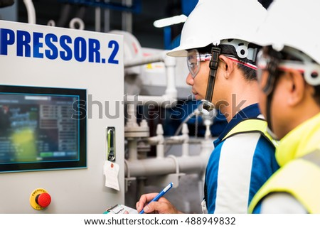 Mechanical inspector and training recording to operation monitor of compressor in the plant for production process, routine daily record. Royalty-Free Stock Photo #488949832
