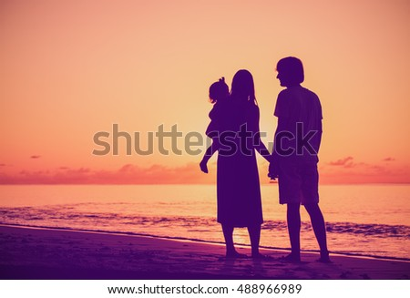 Happy family with little daughter together at sunset #488966989