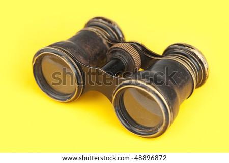 Old binoculars on yellow background #48896872