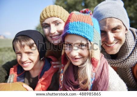 Portrait of family in autumn  #488985865