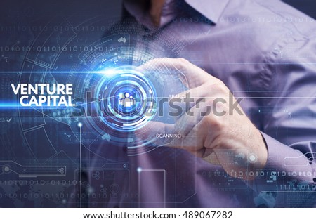 Business, Technology, Internet and network concept. Young businessman working on a virtual screen of the future and sees the inscription: venture capital Royalty-Free Stock Photo #489067282