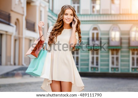 happy young woman with shopping bags #489111790