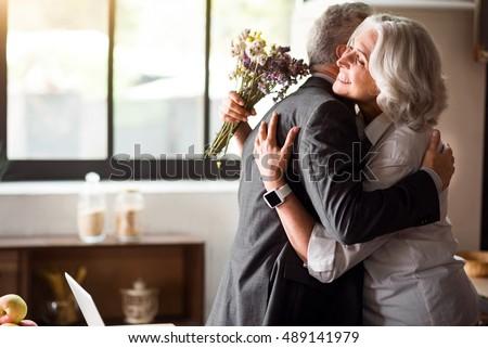 Happy elderly couple celebrating wedding anniversary Royalty-Free Stock Photo #489141979