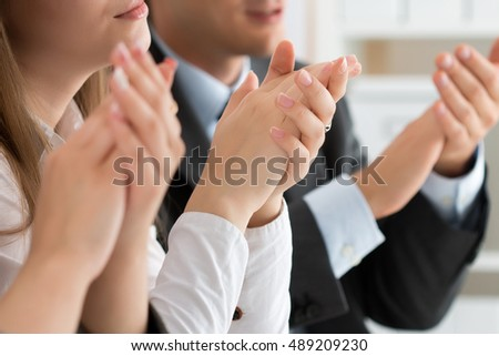 Close up view of business seminar listeners clapping hands. Professional education, business meeting, presentation or coaching concept #489209230