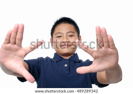 Boy with funny expression gesture open hand fingers isolated #489289342