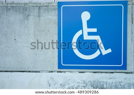 disable sign on wall, handicapped sign #489309286