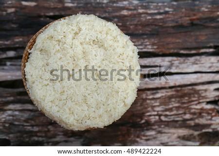 Sticky rice on wood background #489422224
