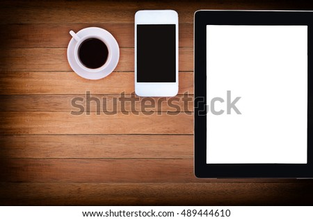 phone, blank note paper, pencil and coffee cup on wood desk top view. empty space for text. selective focus. #489444610