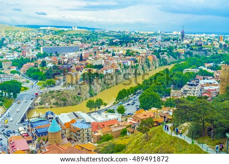 The view on Kura River and its rocky shores from the Sololaki Hill, Tbilisi, Georgia. #489491872