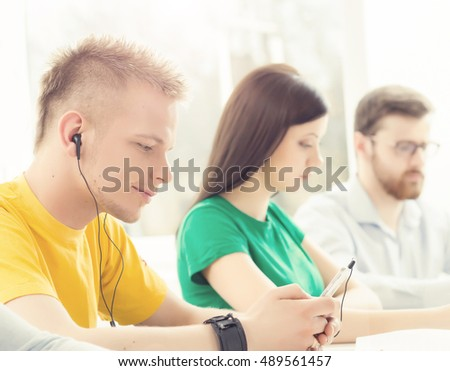 Hipster guy learning to the music in a classroom #489561457