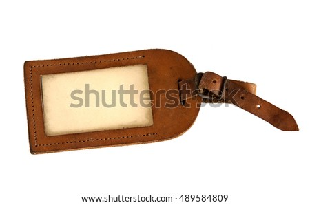 Vintage brown leather luggage tag isolated on white background
