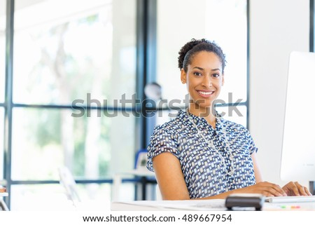 Portrait of smiling afro-american office worker in offfice #489667954