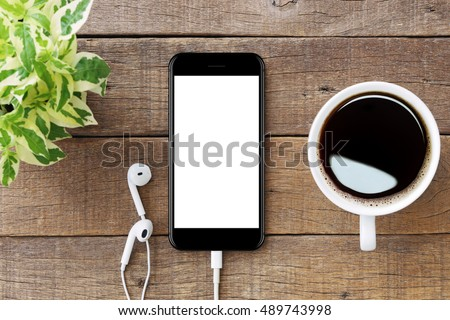 smartphone white screen on wooden table, mockup modern smartphone jet black color