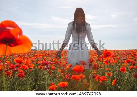 girl in white dress in the poppy field #489767998