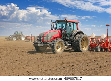 Tractor and Seeder Planting Crops on a Field #489807817