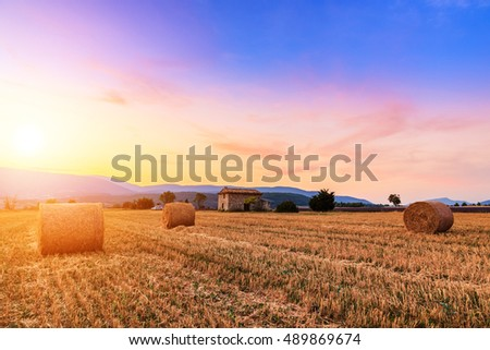 Sunset over farm field with hay bales near Sault, Provence-France #489869674