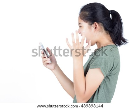 Angry mad young woman shouting and using mobile phone over white background #489898144