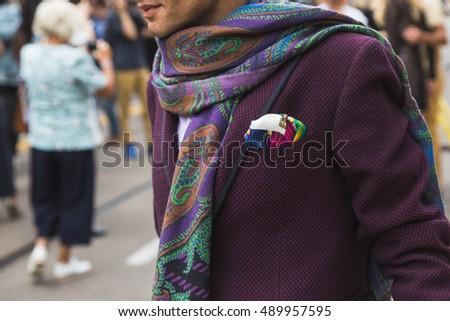 MILAN, ITALY - SEPTEMBER 22, 2016: Fashionable man poses outside Fendi fashion show building during Milan Women Fashion Week SS17. #489957595