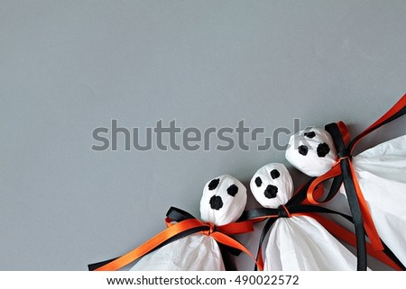 Halloween concept background : Three halloween ghosts DIY made from white tissue paper, black and orange ribbon on gray background  #490022572