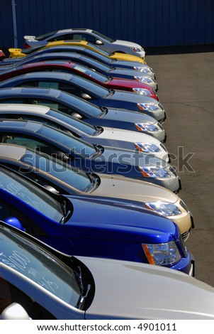 A row of new cars parked at a car dealer shop #4901011