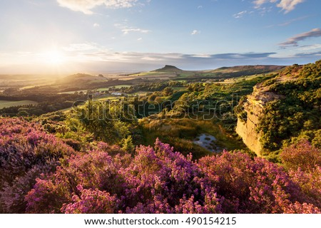 Sunset behind Roseberry Topping, taken from Cockshaw Hill in the North York Moors National Park. Royalty-Free Stock Photo #490154215