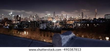 City Skyline. Manhattan, Seen from Brooklyn at Night.