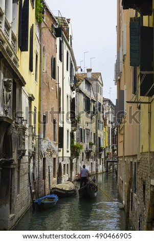 Canal with gondolas in Venice, Italy #490466905